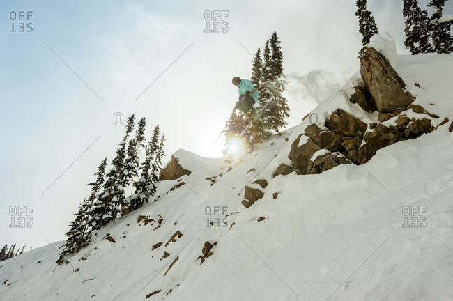 Extreme skier in mid-air after cliff jump, Crested Butte, Colorado, USA
