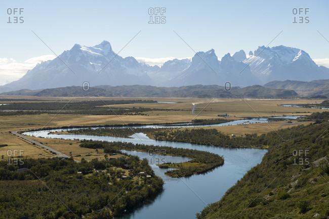 Rio Serrano river and mountain range in Torres del Paine National Park, Magallanes Region, Chile
