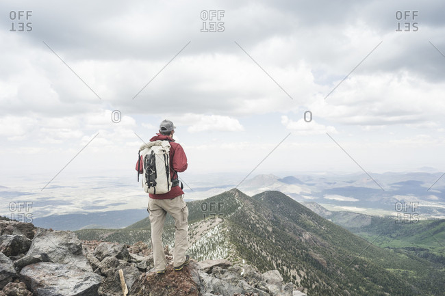 Backpacker in mountains on trail to Humphreys Peak, Kachina Peaks Wilderness, Flagstaff, Arizona, USA