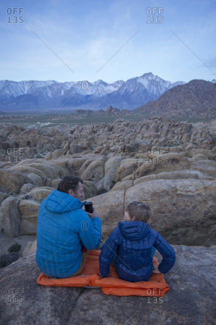 Father and son and Sierra Nevada Mountains, Alabama Hills Recreation Area, Lone Pine, California, USA