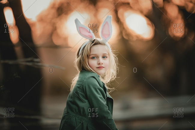 Young girl wearing bunny ears