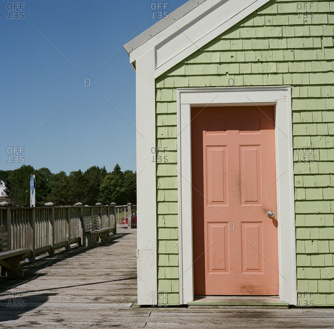 Seaside building with pink door