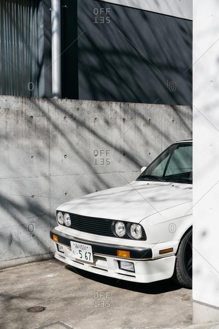 Tokyo, Japan - November 4, 2016: White car in alleyway