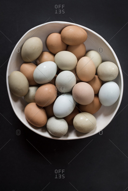 Fresh, colorful eggs in a bowl
