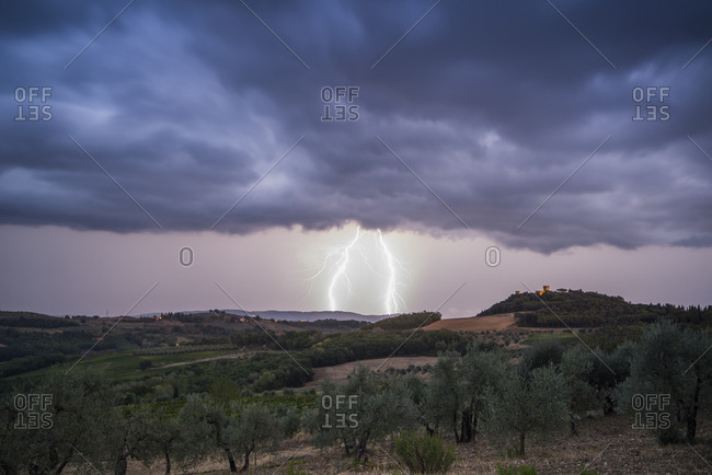 "Italy, Tuscany, Certaldo . storm above Santa Maria Novella Castle. Certaldo is a town and comune of Tuscany, Italy, in the Metropolitan City of Florence, in the middle of Valdelsa. It is about 35 kilometers (22 mi) southwest of the Florence Duomo. It was the home of the family of Giovanni Boccaccio, the poet of ""Vita di Dante,"" and the author of the ""Decamerone"". He died here at his home and was buried here in 1375."