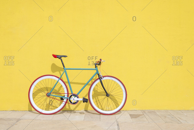 Vintage bike leaning on a yellow wall at Barcelona, Spain