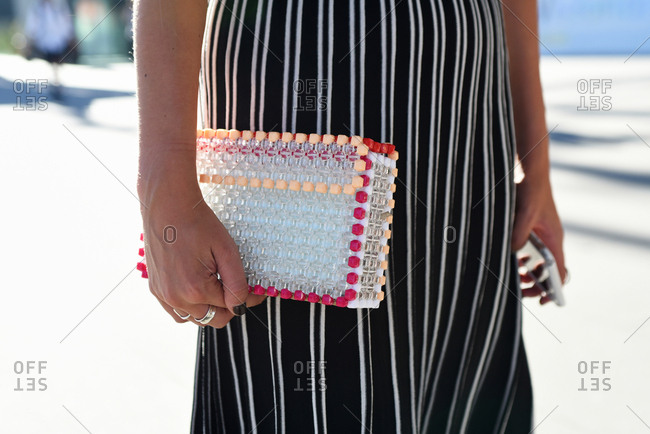 Close Up of Woman Holding Hand Made Plastic Clutch Bag, Horizontal