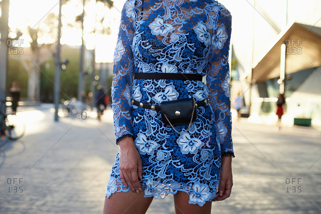 Cross Section of Stylish Woman Wearing Blue Lace Dress and  Belt Bag