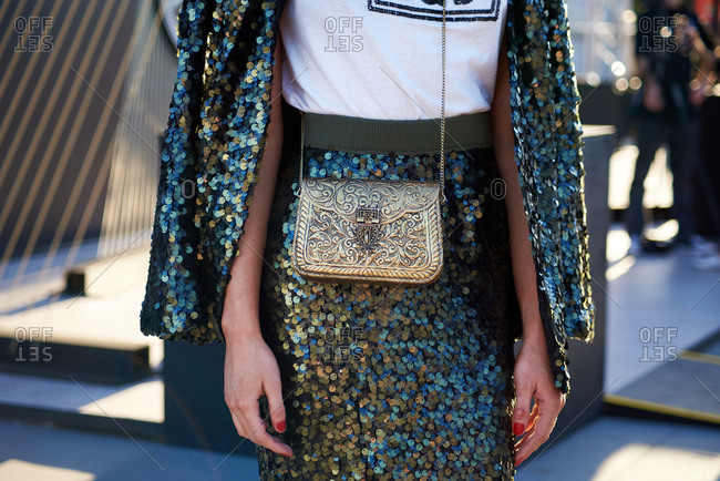 Midsection of Stylish Woman Wearing Sequin Skirt and Jacket with Golden Cross Body Bag