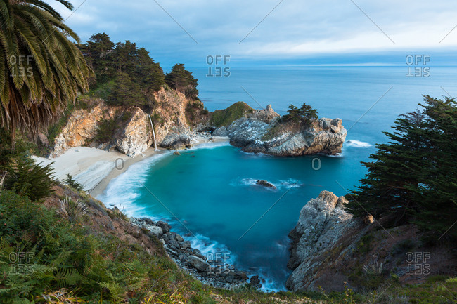 Mcway Falls in Big Sur pours into the pacific ocean of California