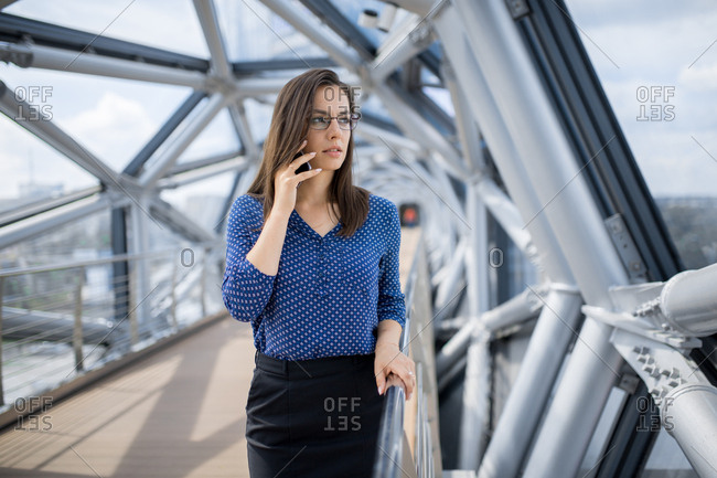 Young professional businesswoman talking on cell phone