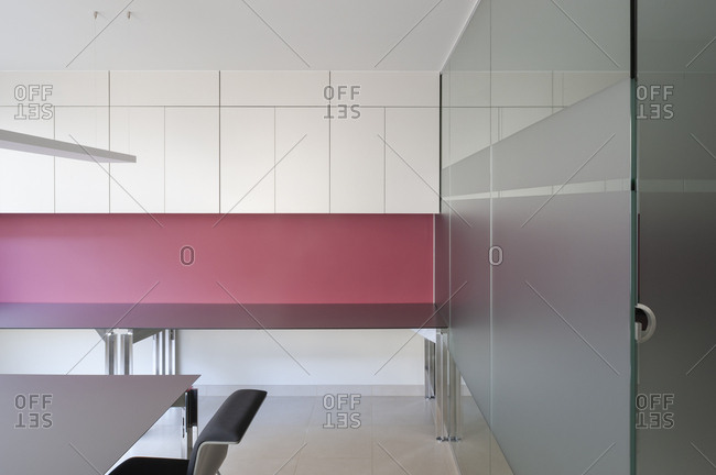 Interior of modern business office with red wall