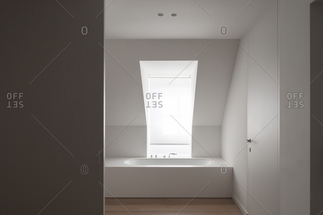 Minimalist bathtub inside modern bathroom