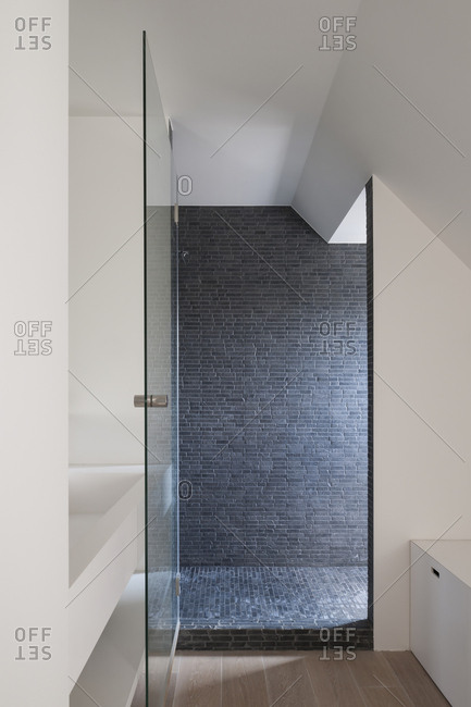 Minimalist shower area inside modern bathroom