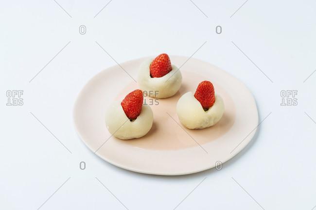 Mochi Japanese dessert with strawberries