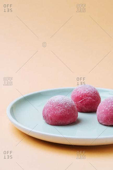 Vertical shot of pink mochi Japanese dessert