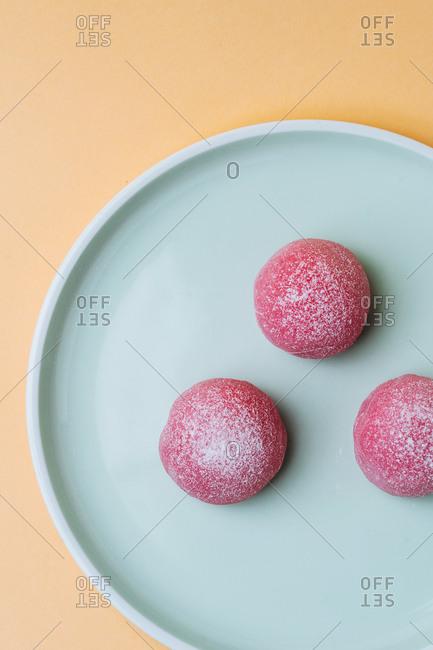 Overhead shot of pink mochi Japanese dessert