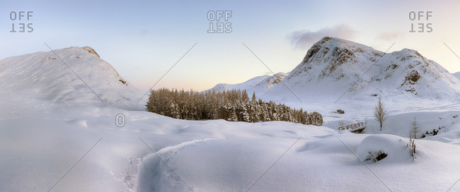 A panoramic snow covered Sunset view from the west highland way, Glencoe, taken on January after a few days of heavy snowfall.
