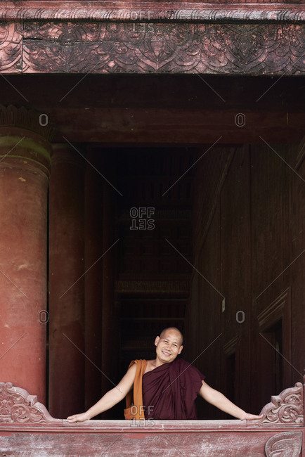 Mandalay, Myanmar - November 11, 2017: Portrait of smiley senior monk at monastery of Royal Palace