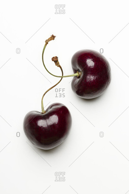 Top view of two cherries on white background