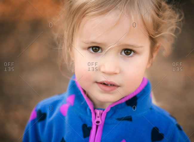 Portrait of a little blonde girl with brown eyes