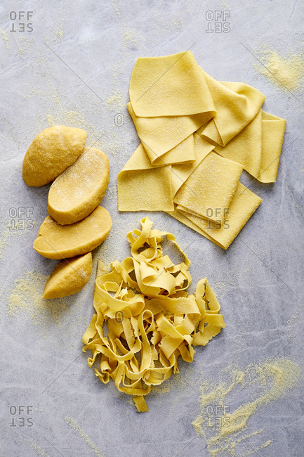 Homemade pasta on marble surface and flour