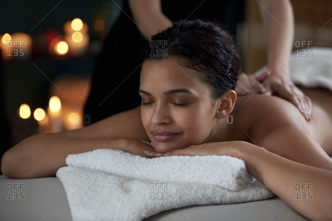 Pretty girl relaxing having a massage at day spa salon, pamper session
