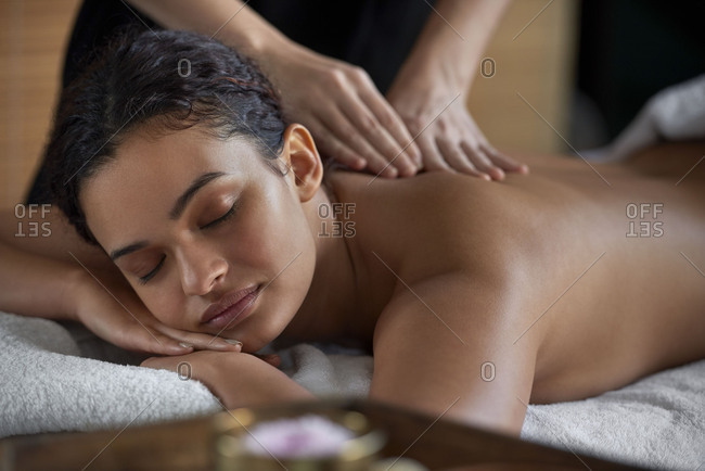 Young woman receiving a relaxing back rub at a spa
