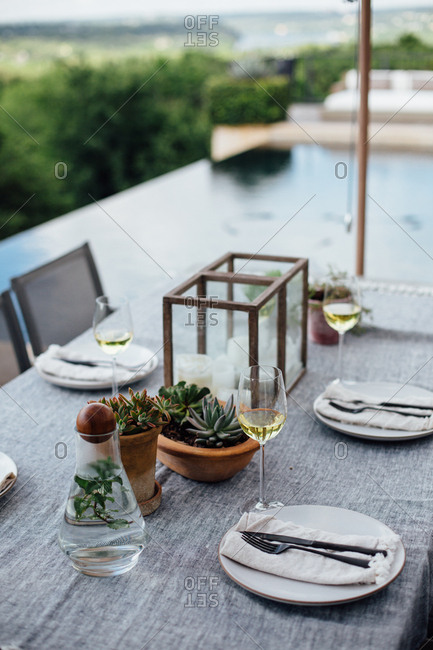 Outdoor dining table near pool