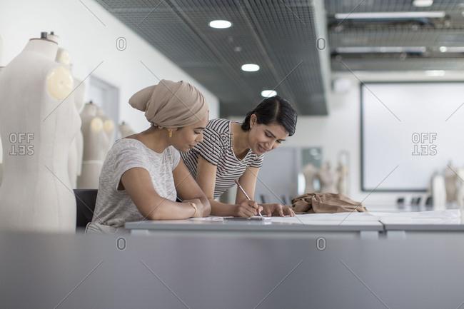 Muslim female fashion designers working on ideas