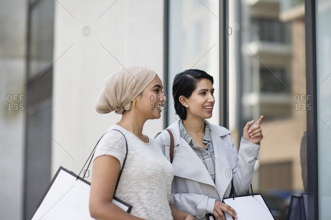 Muslim friends window shopping