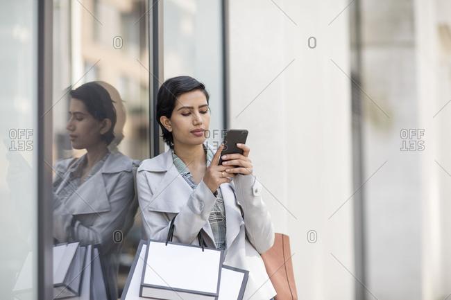 Arabic woman using a smartphone on a shopping trip