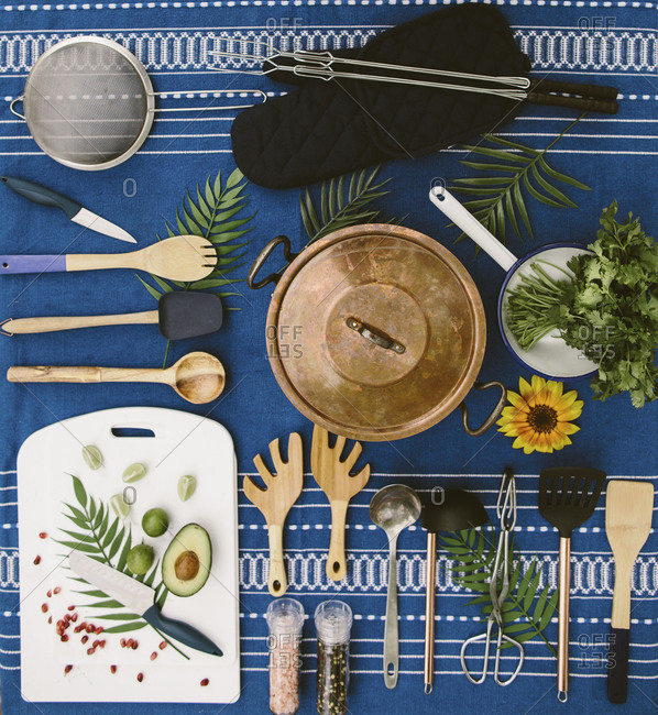 Flat-lay of camping cooking supplies on a picnic table
