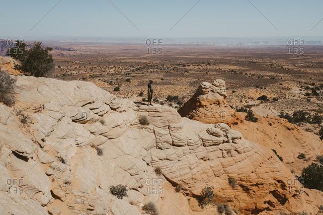 Man hiking orange rock desert landscape, Utah