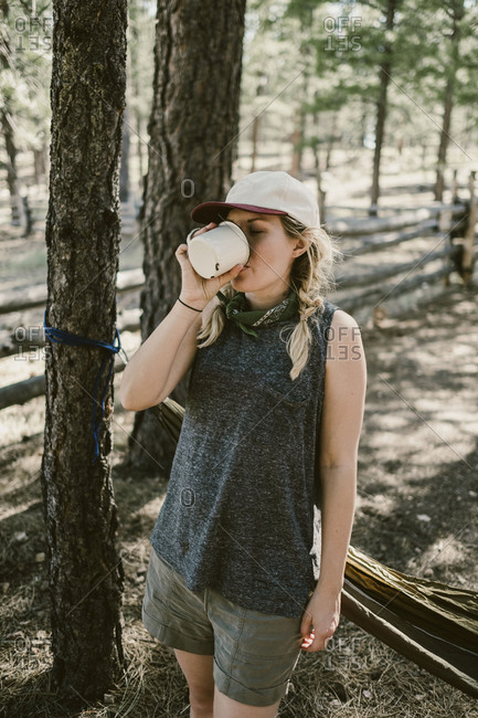 Woman drinking coffee while camping