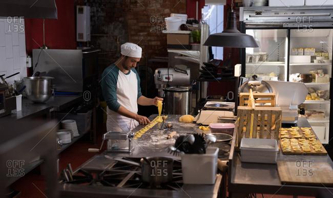 Male baker preparing for making pasta