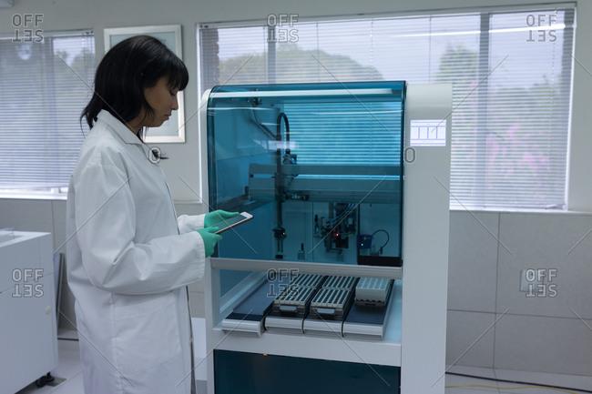 Laboratory technician using digital tablet in blood bank