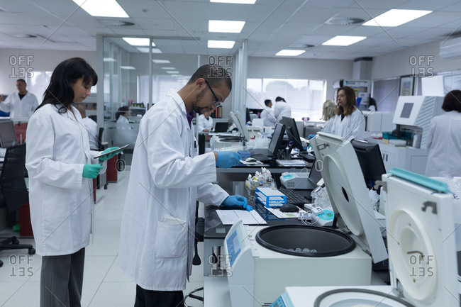 Team of laboratory technicians working together in blood bank