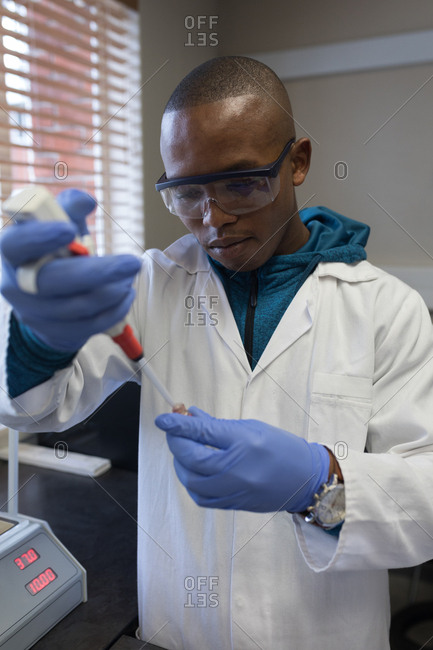 Laboratory technician analyzing blood samples in blood bank