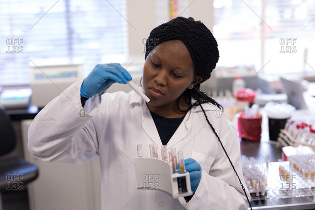 Laboratory technician analyzing chemical solution in blood bank