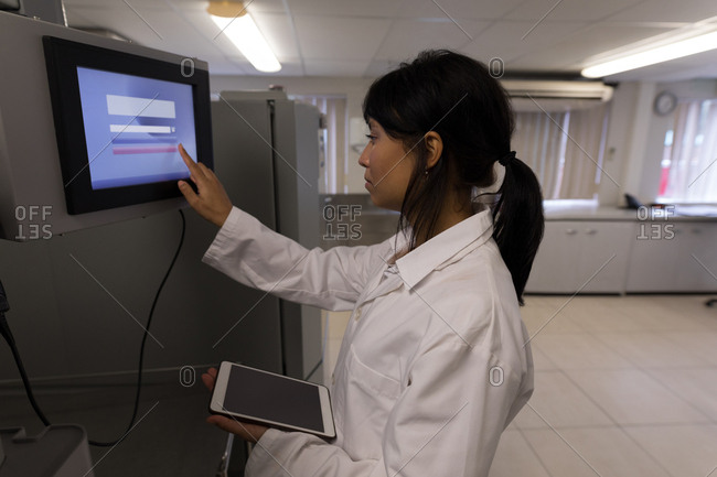 Laboratory technician using a display monitor in blood bank