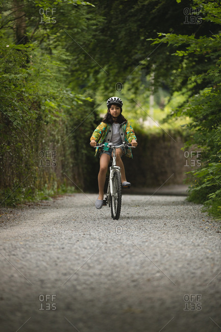 Young girl riding bicycle on street