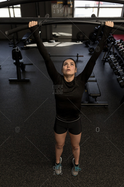 Fit woman exercising in fitness gym