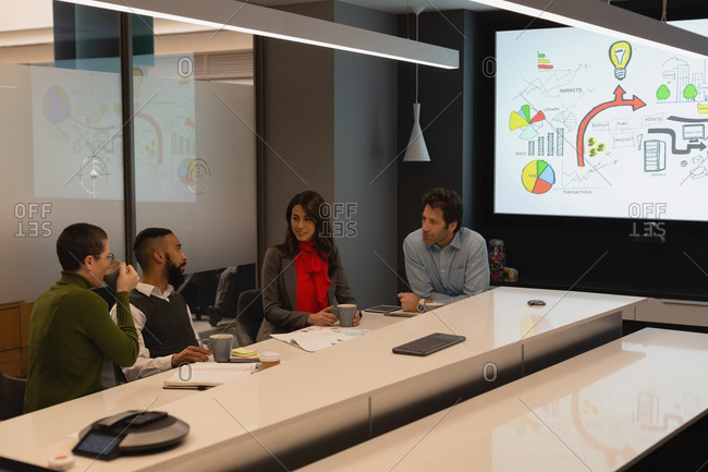 Business people interacting in conference room at office