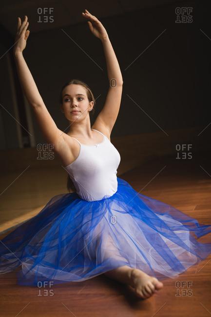 Ballerina practicing ballet dance in the dance studio