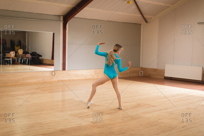 Ballerina practicing ballet dance in ballet studio
