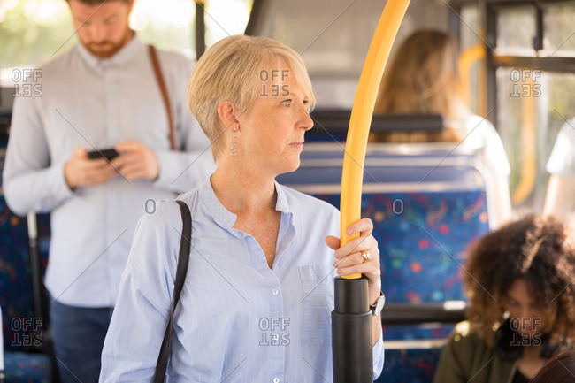 Thoughtful woman travelling in modern bus