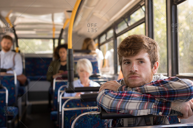 Thoughtful man travelling in modern bus