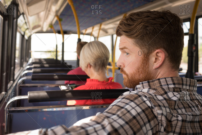 Smart male commuter travelling in modern bus
