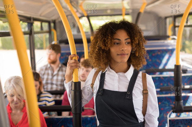 Young female commuter travelling in modern bus